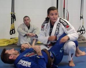 Jonathan Fader observing Luanna Alzuguir and Scott Scott Boudreau demonstrate the fine points of BJJ